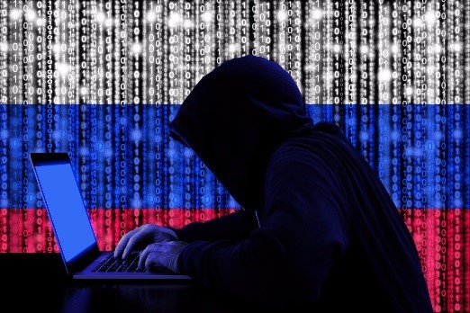 hacker on laptop russia