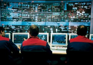 engineers managing control system